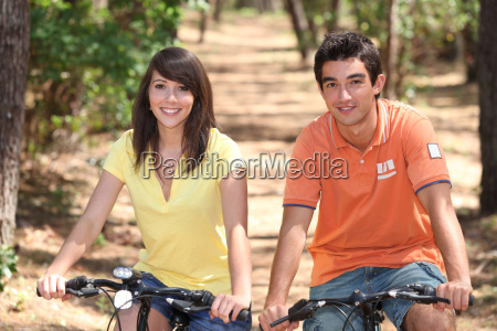 teenage couple on bike ride
