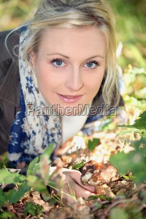 woman gathering mushrooms