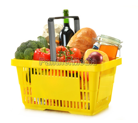 shopping basket and groceries isolated on
