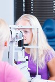 optometry pretty young female patient having