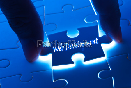web development on puzzle piece