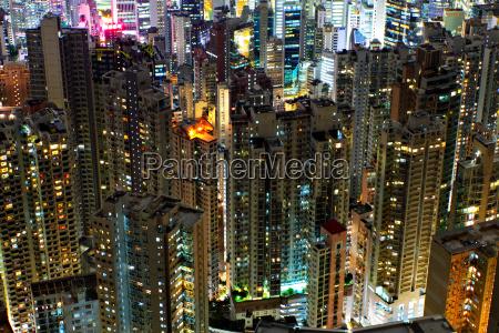 buildings at night in hong kong