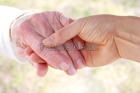 young holding senior lady039s hand
