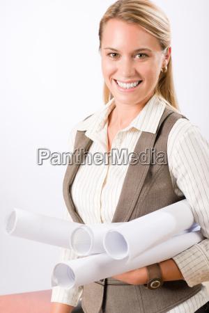 female architect blueprints smiling hold