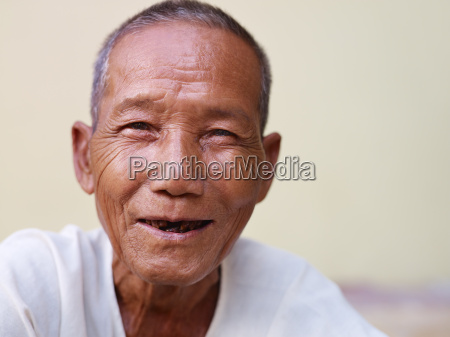 portrait of happy old asian man