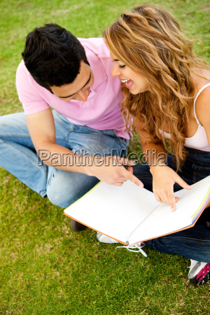 couple studying outdoors