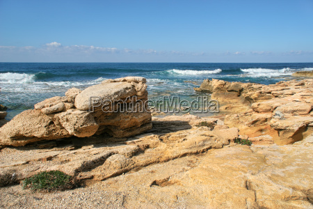 view on coastal yellow rocks on
