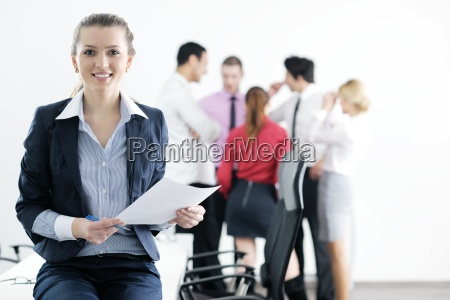business woman standing with her staff
