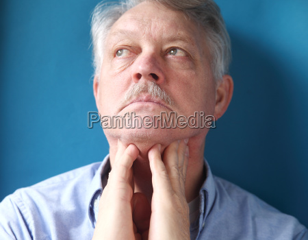 man feeling painful lymph glands