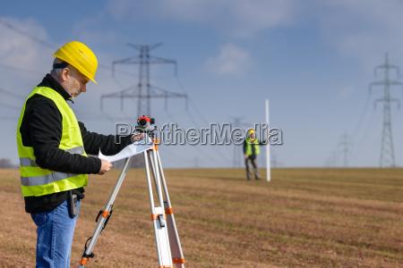 geodesist measure land on construction site