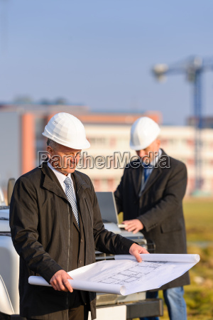 two architects at construction site review