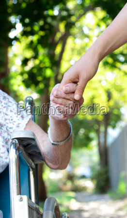 holding hands with senior lady