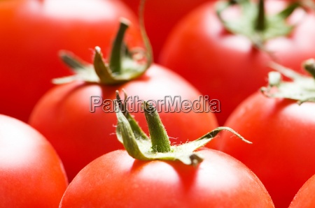 red tomatoes arranged at the market