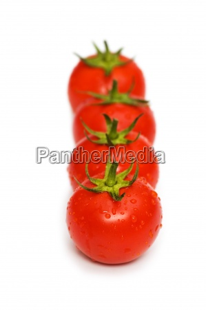 four tomatoes isolated on the white