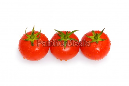 three tomatoes isolated on the white