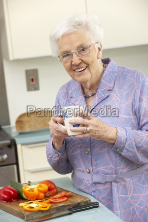 senior woman preparing food in domestic