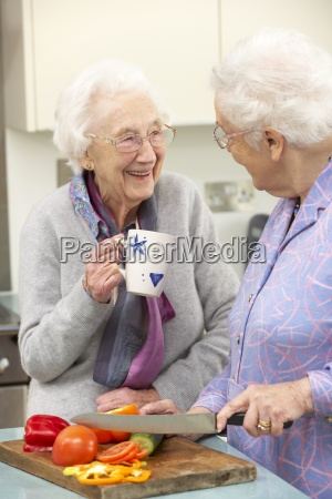 senior women preparing meal together