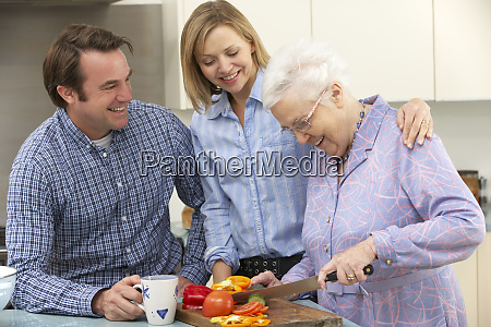 senior woman and family preparing meal