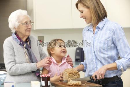 multi generation family preparing food in