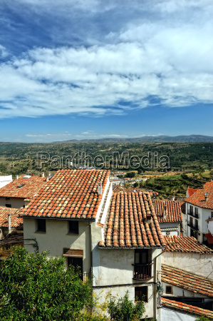 small spanish town with mountain view