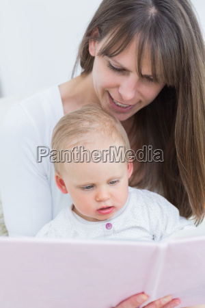 mother reading a book to a
