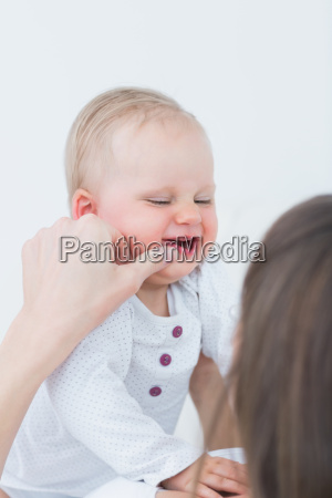 mother touching the cheek of a