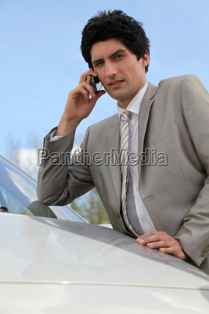 annoyed businessman talking on his mobile