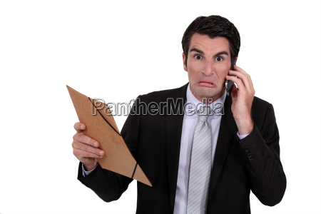 an angry businessman over the phone