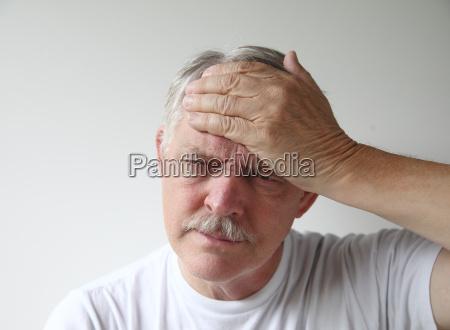 man has a headache