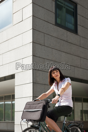 woman riding bicycle and going to