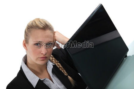 bored woman working on her laptop