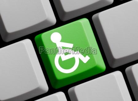 rollstuhl symbol auf computer tastatur