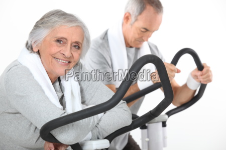 a mature couple exercising