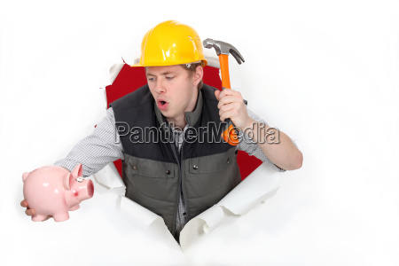 tradesman about to break open his