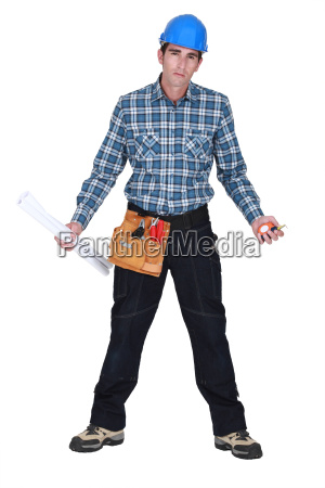 unhappy tradesman holding his tools and