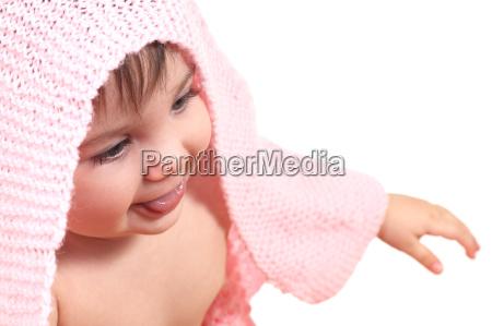 baby under a pink blanket