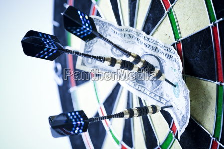 darts target and dollar in bulls