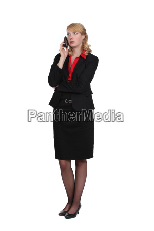 exasperated woman talking on her mobile