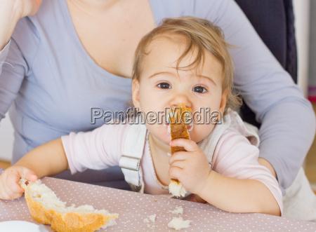 cute baby eating bread
