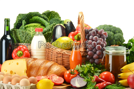 groceries in wicker basket including vegetables