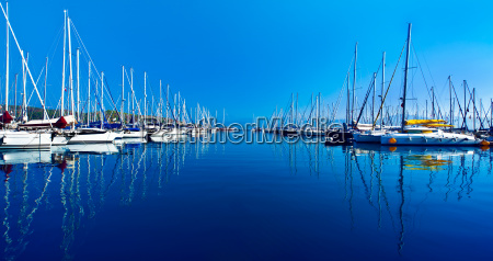 yacht port over blue nature scene