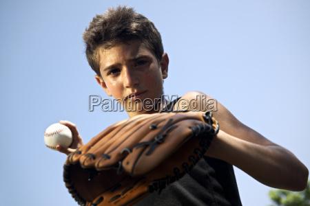 sportbaseball und kinderportraet des kindes zu