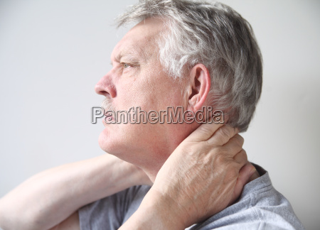 man with pain in neck
