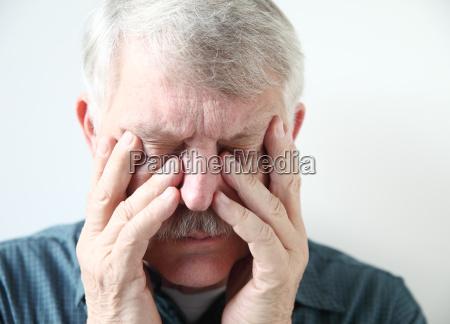 senior suffering from sinus pressure
