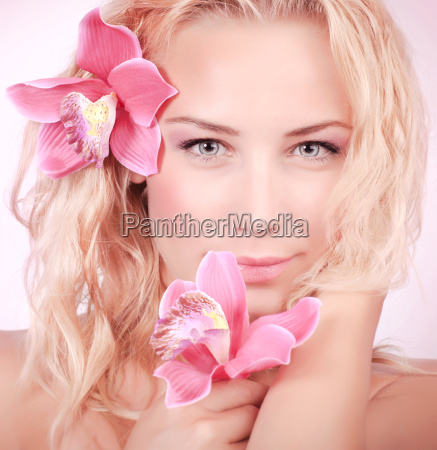 cute girl with orchid flowers
