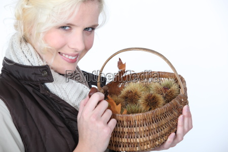 woman with basket of chestnuts