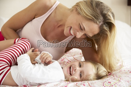 mother and daughter relaxing together in