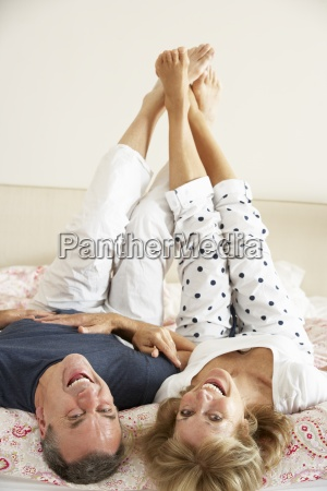 senior couple lying upside down together