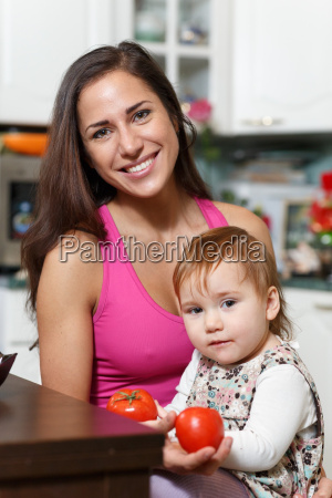 mother with child in the kitchen