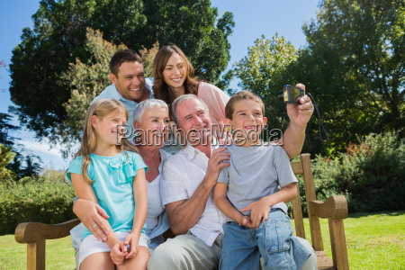 family sitting on a bench taking